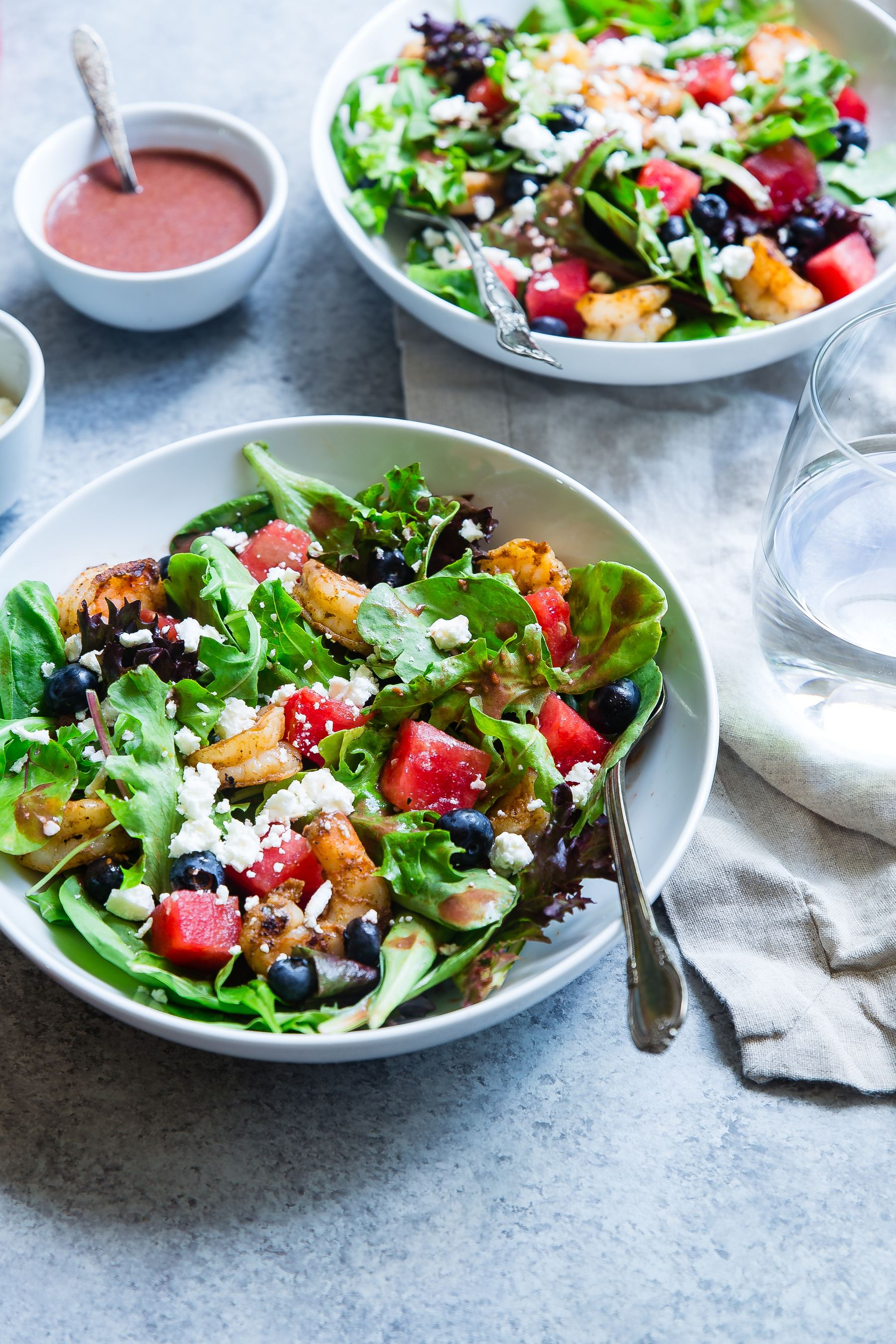 Photo of salad on table with dressing